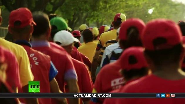 2013-05-10 - RT reporta (E11): Venezuela, la voz del pueblo